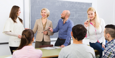 classroom scene with students and instructors